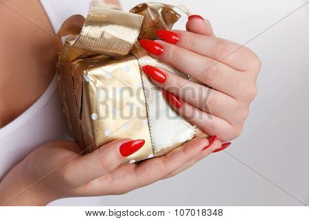 Closeup Of A Woman's Hand On A Wrapped Box