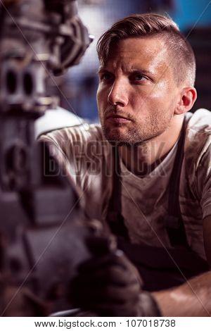 Mechanic Working With Engine