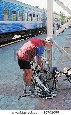 The Bicyclist Packs A Bicycle At Station
