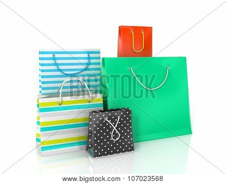 Five Colorful Paper Bags For Shopping On A White Background.