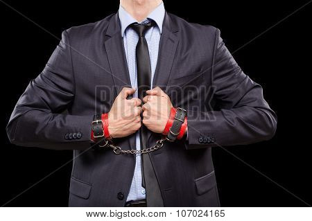 man in a business suit with leather bound. handcuffs. sex Toys