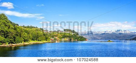 Meadows And Village On Hardanger Fiord.