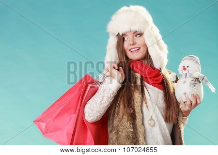 Winter Woman With Little Snowman And Bags Shopping