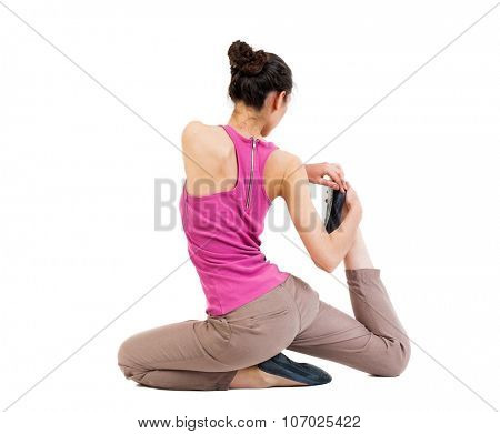 Back view of the girl sitting in front of a warm up exercise.  Rear view people collection.  backside view of person.  Isolated over white background. African-American in a complex yoga pose.