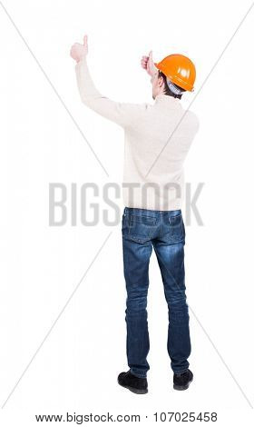 Back view of builder in helmet shows thumbs up.   Rear view people collection.  backside view of person.  Isolated over white background. Engineer approval shows the fingers of both hands