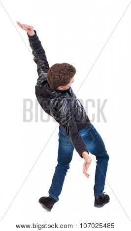 Balancing young man or dodge falling man. Rear view people collection.  backside view of person.  Isolated over white background. The guy in the leather jacket falls on his back.