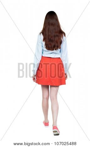 back view of walking woman.   beautiful blonde girl in motion.  backside view of person.  Rear view people collection. Isolated over white background. girl in red short skirt goes deep into the frame.