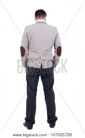 back view of Business man  looks.  Rear view people collection.  backside view of person.  Isolated over white background. A guy in a jacket hung his head sadly.