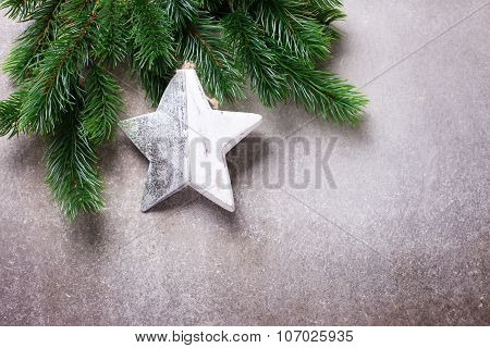 Spruce Branches  And Christmas Star On Grey Slate Background.