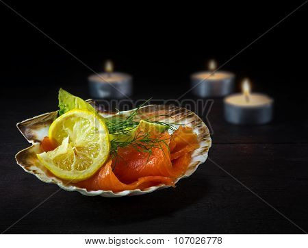 Smoked Salmon In A Scallop Shell As Festive Appetizer On Dark Wood