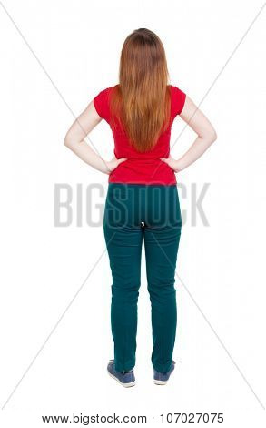 back view of standing young beautiful  woman in jeans. girl  watching. Rear view people collection.  backside view of person.  Isolated over white background. Girl in green trousers looking up.