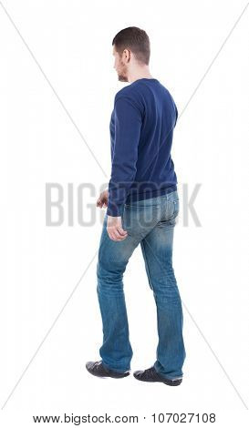 Back view of going  handsome man. walking young guy . Rear view people collection.  backside view of person.  Isolated over white background. The guy in the demi-season jacket leaves.