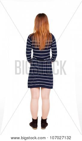 back view of standing young beautiful  woman in jeans. girl  watching. Rear view people collection.  backside view of person.  Isolated over white background. Modest girl standing with her hands.