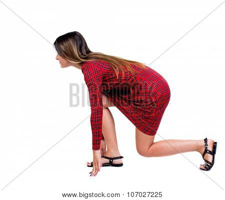 side view woman start position.  Rear view people collection.  backside view of person.  Isolated over white background.  Long-haired girl in a red plaid dress in a starting position looks ahead.