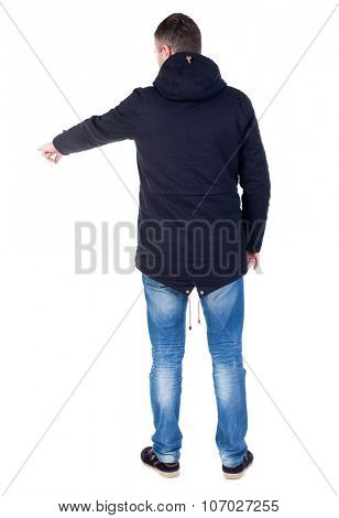 Back view of  pointing young men in parka. Young guy  gesture. Rear view people collection.  backside view of person.  Isolated over white background.