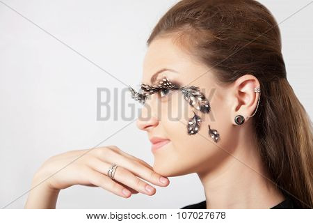 Beautiful Woman With Long Eyelashes And Face-art In Profile