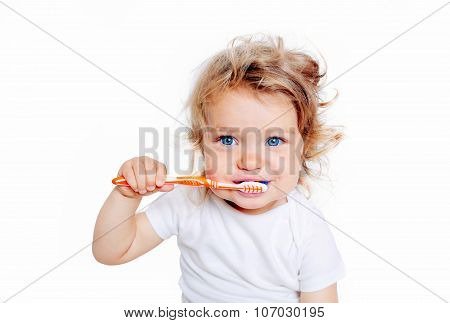Curly Baby Toddler Brushing Teeth.