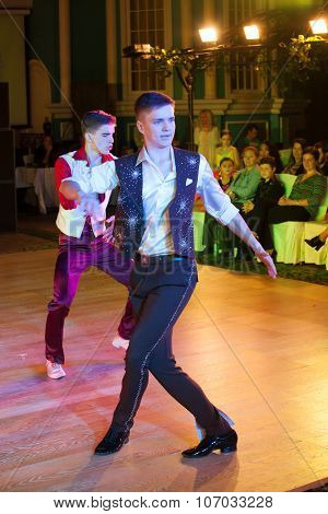 MOSCOW - OCTOBER 18: Unidentified male teens age 15-18 competes in latino dance on the Artistic Dance Awards 2014-2015, organized by World Dance Artistic Federation on October 18, 2015 in Moscow.