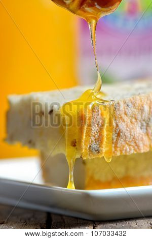 Honey Pouring Over Bread