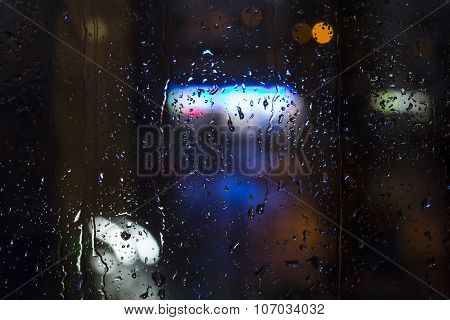 Rain drops on window - night light