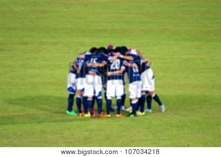 Blur Image Of Rear View Of Soccer Players Which Discussing Strat