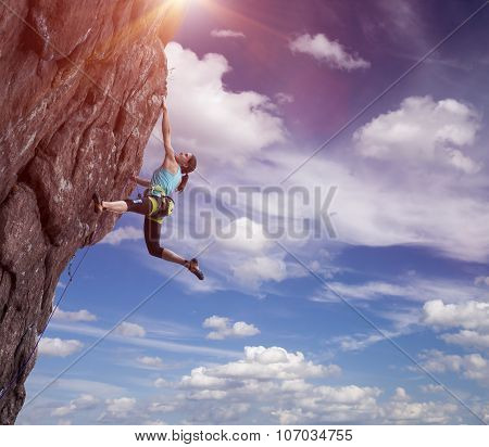Climber hanging on her hand