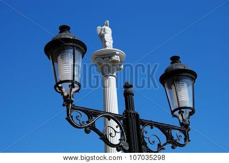 Streetlight and monument, Fuengirola.