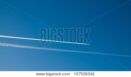 Long Tracks Of Airplane In The Blue Sky