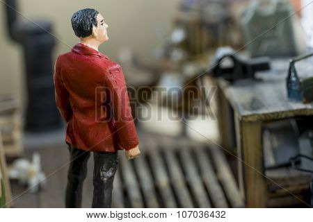 Man With A Red Jacket Standing In A Model Lodge