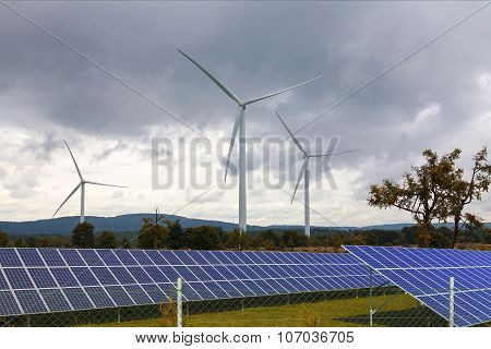 Wind turbines with solar panels