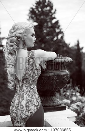 Elegant Woman In Mermaid Gorgeous Dress At Park. Wedding Hairstyle. Outdoor Black And White Portrait