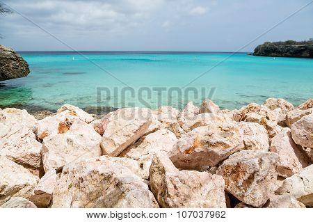 Rock Seawall And Clear Aqua Sea