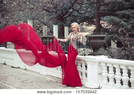 Beautiful Elegant Woman Wearing In Long Mermaid Fluttering Fashion Dress In Winter Park, Outdoors Fu