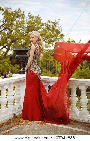 Young Beautiful Caucasian Woman In Gorgeous Red Dress With Waving Flying Fabric, Fashion Female Posi