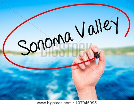 Man Hand writing Sonoma Valley with black marker on visual screen.