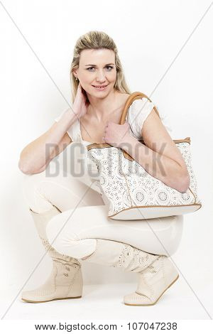 woman wearing summer boots with a handbag