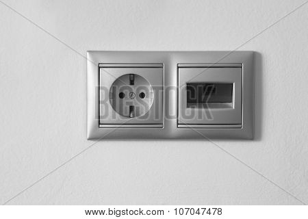 Electrical And Ethernet Socket On A Textured White Wall
