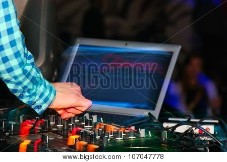 DJ mixer at a nightclub. close-up
