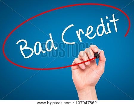 Man Hand writing Bad Credit with black marker on visual screen.