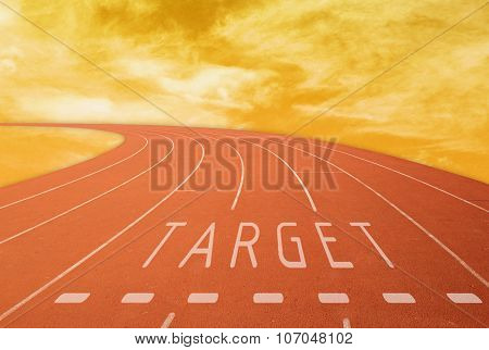 Outdoor Running Track With Sign Target At Sunset