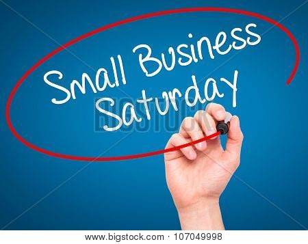 Man Hand writing Small Business Saturday with black marker on visual screen.