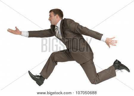 Businessman running fast with empty hand