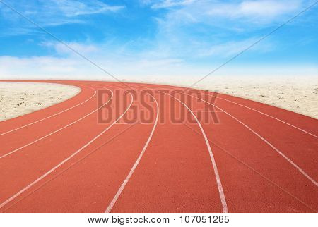 Outdoor Running Track With Desert And Sky Background