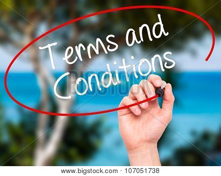 Man Hand writing Terms and Conditions with black marker on visual screen.