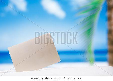 blank retro photo on white sand beach, sky and seascape, shallow dof