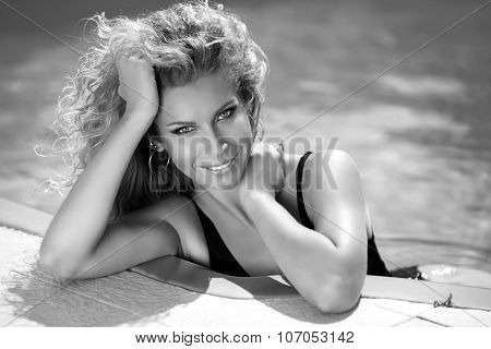 Beautiful Smiling Girl Summer Portrait. Tanned Woman. Sunburn. Bronzed Skin. Gray Shadows Colors. Bl