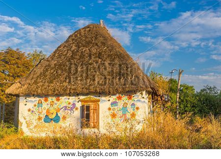 Classic ancient Ukrainian house with haulm roof