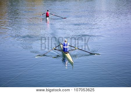 Two Man In A Boats