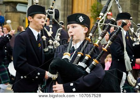 Thurso, Scotland -  August 13 2005. Scottish Traditional Bagpipes Musician Woman
