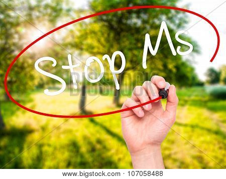 Man Hand writing Stop Ms with black marker on visual screen.